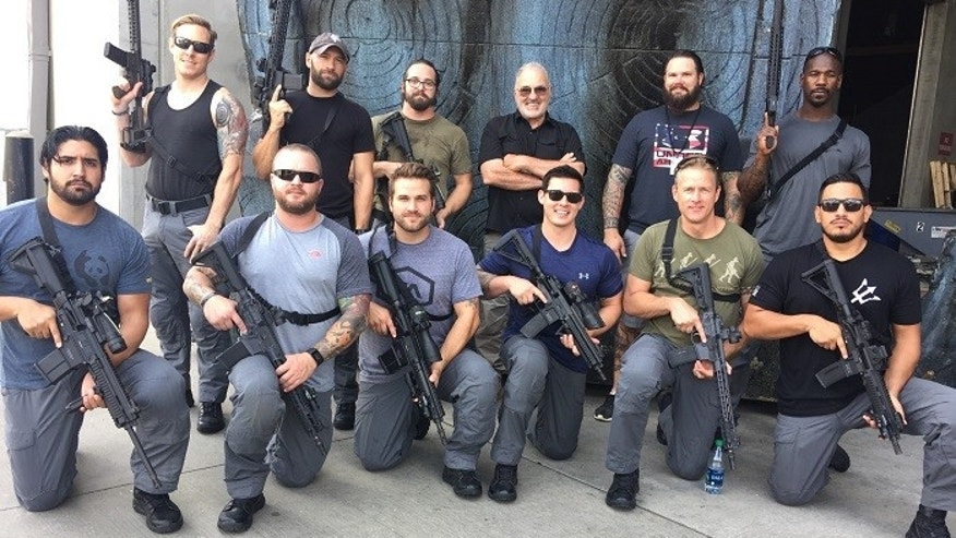 Patrick Bisher and other SEALs on the set of the latest Transformers movie.