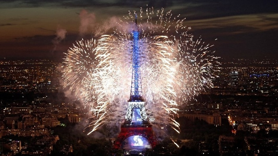 Fireworks explode in the sky above the Eiffel Tower, in a picture taken from the Montparnasse Tower Observation Deck, at the end of Bastille Day events in Paris, France, July 14, 2017.