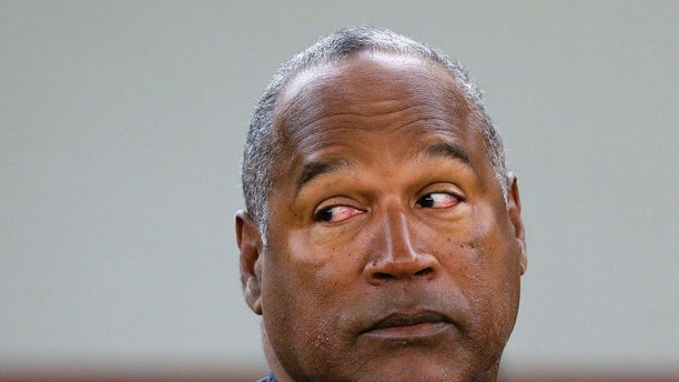 OJ Simpson granted parole after 9 years in prison for robbery