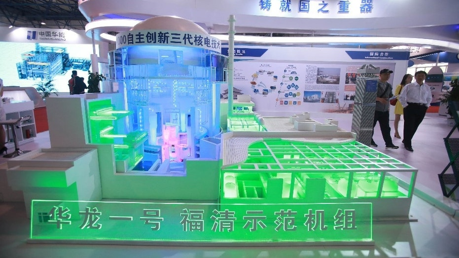"FILE -- A model of the nuclear reactor ""Hualong One"" is pictured at the booth of the China National Nuclear Corporation (CNNC) at an expo in Beijing, China April 29, 2017."