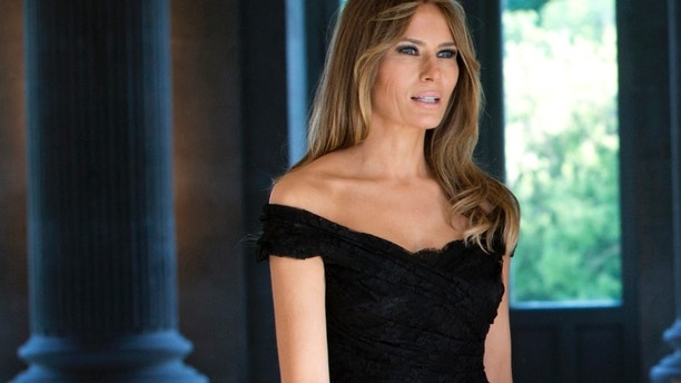Melania Trump wears a black Dolce & Gabbana dress prior to a group photo during the spouse and partner program at the Royal Palace of Laeken, near Brussels on May 25, 2017.