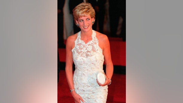 "FILE - In this Tuesday Sept. 24, 1996 file photo, Britain's Diana, Princess of Wales, arrives for dinner in Washington. It has been 20 years since the death of Princess Diana in a car crash in Paris and the outpouring of grief that followed the death of the ""people's princess."" (AP Photo/Denis Paquin, File)"