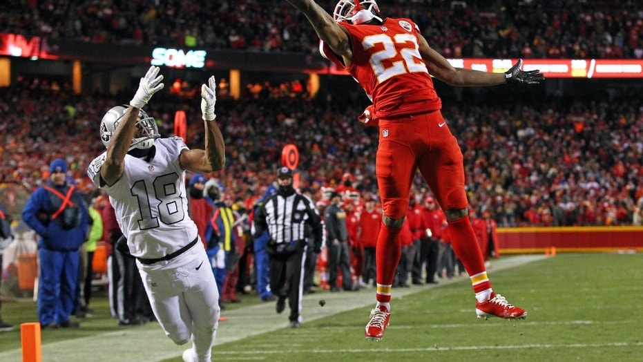 FILE -- Dec 8, 2016; Kansas City, MO, USA; Kansas City Chiefs cornerback Marcus Peters (22) breaks up a pass intended for Oakland Raiders wide receiver Andre Holmes (18) during the second half at Arrowhead Stadium.