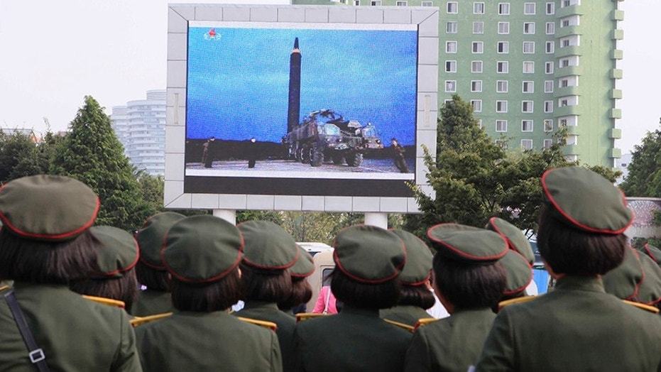 People fill the square of the main railway station to watch a televised news broadcast of the test-fire of an inter-continental ballistic rocket Hwasong-12, Wednesday, August 30, 2017, in Pyongyang, North Korea.