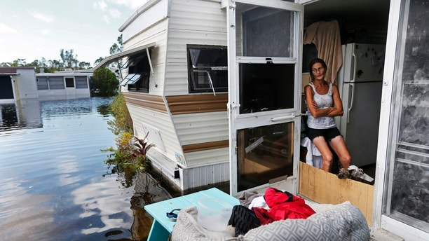Cherie Ethier Sits In Her Mobile Home With Pets Surrounded By Floodwater The