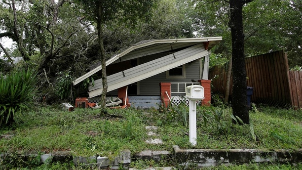 A home damaged by a tree is seen after Hurricane Irma made landfall in Tampa, Florida, U.S., September 11, 2017. REUTERS/Chris Wattie - RC191FE2E410