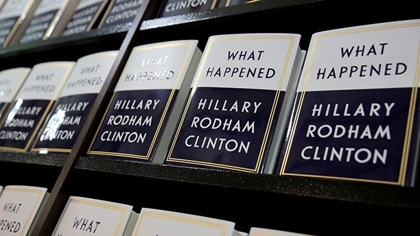 "Former Secretary of State Hillary Clinton's new book ""What Happened"" sits on shelves at Barnes & Noble bookstore at Union Square in Manhattan, New York City, U.S., September 12, 2017.  REUTERS/Andrew Kelly - RC1FA9931FB0"