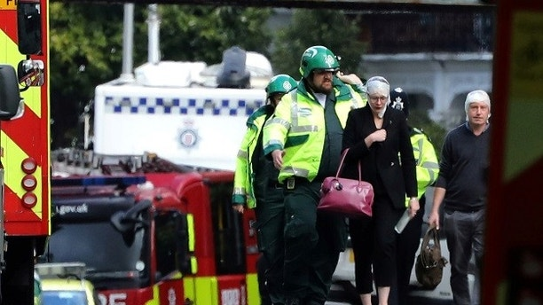 An injured woman is led away after an incident at Parsons Green underground station in London, Britain, September 15, 2017.  REUTERS/Luke MacGregor - RC1F274B6C70