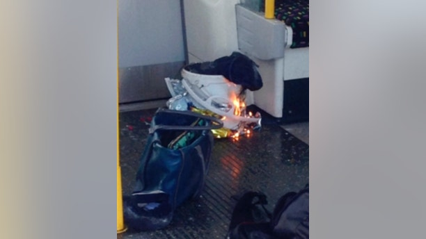 "In this image made from video, fire raises at a southwest London subway station in London Friday, Sept. 15, 2017. London's Metropolitan Police and ambulance services are confirming they are at the scene of ""an incident"" at the Parsons Green subway station in the southwest of the capital. The underground operator said services have been cut along the line. (@RRIGS via AP)"
