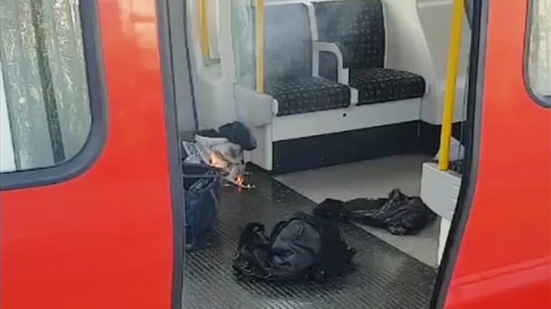 This is an image made from video showing burning items in underground train at the scene of an explosion in London Friday, Sept. 15, 2017. A reported explosion at a train station sent commuters stampeding in panic, injuring several people at the height of London's morning rush hour, and police said they were investigating it as a terrorist attack. (Sylvain Pennec via AP)