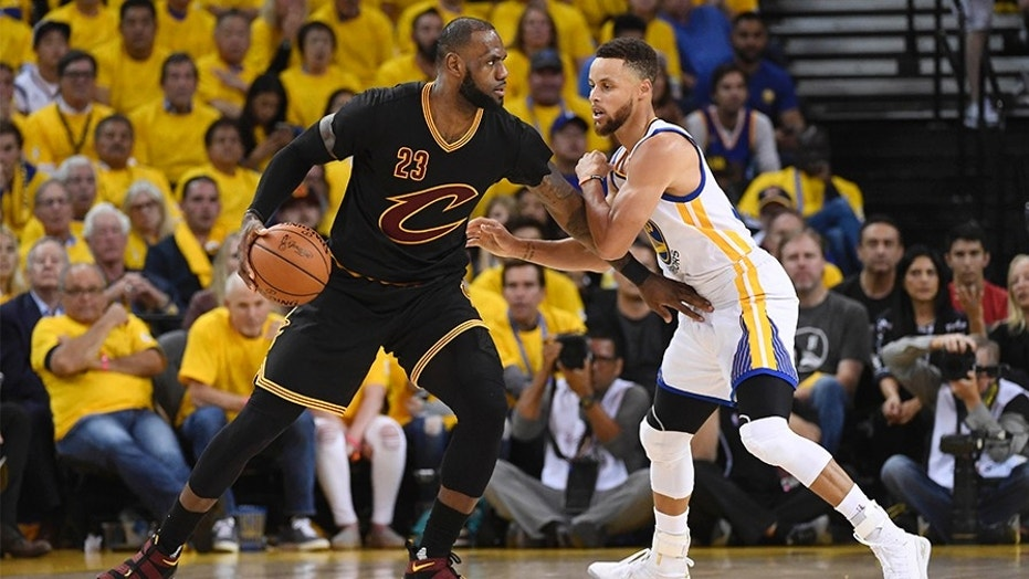 FILE -- Jun 12, 2017; Oakland, CA, USA; Cleveland Cavaliers forward LeBron James (23) is defended by Golden State Warriors guard Stephen Curry (30) during the third quarter in game five of the 2017 NBA Finals at Oracle Arena.