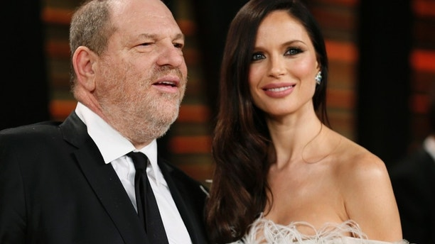 Producer Harvey Weinstein and his wife, actress Georgina Chapman arrive at the 2014 Vanity Fair Oscars Party in West Hollywood, California March 2, 2014.