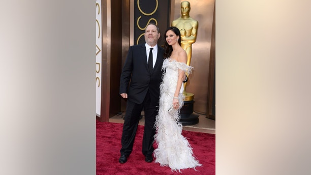 Harvey Weinstein, left, and Georgina Chapman arrive at the Oscars on Sunday, March 2, 2014, at the Dolby Theatre in Los Angeles.