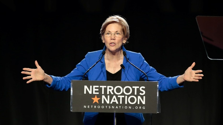 FILE -- Senator Elizabeth Warren (D-MA) addresses the audience at the morning plenary session at the Netroots Nation conference for political progressives in Atlanta, Georgia, U.S. August 12, 2017.