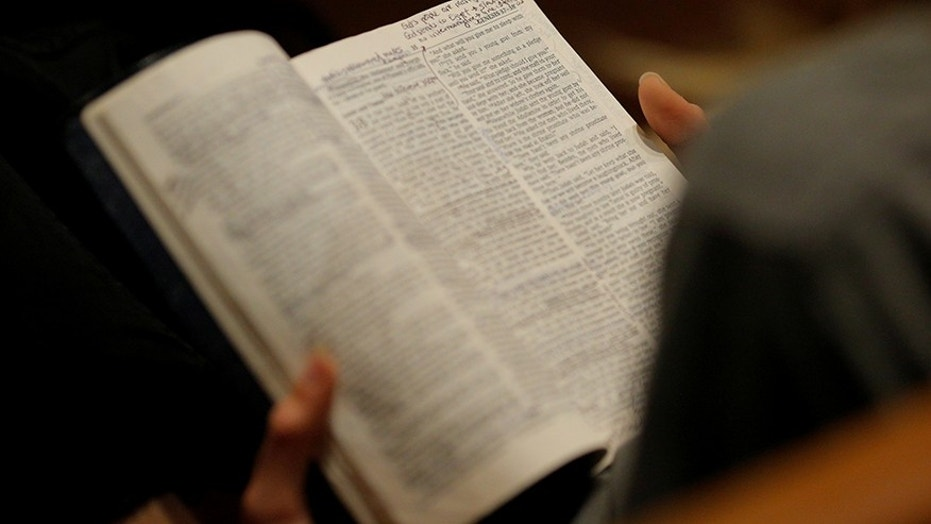 FILE -- A woman reads her bible.