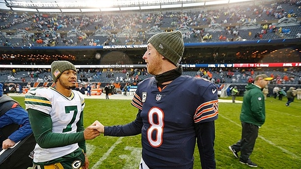 Green Bay Packers quarterback Brett Hundley (7) greets Chicago Bears quarterback Mike Glennon (8) after an NFL football game, Sunday, Nov. 12, 2017, in Chicago. (AP Photo/Charles Rex Arbogast)