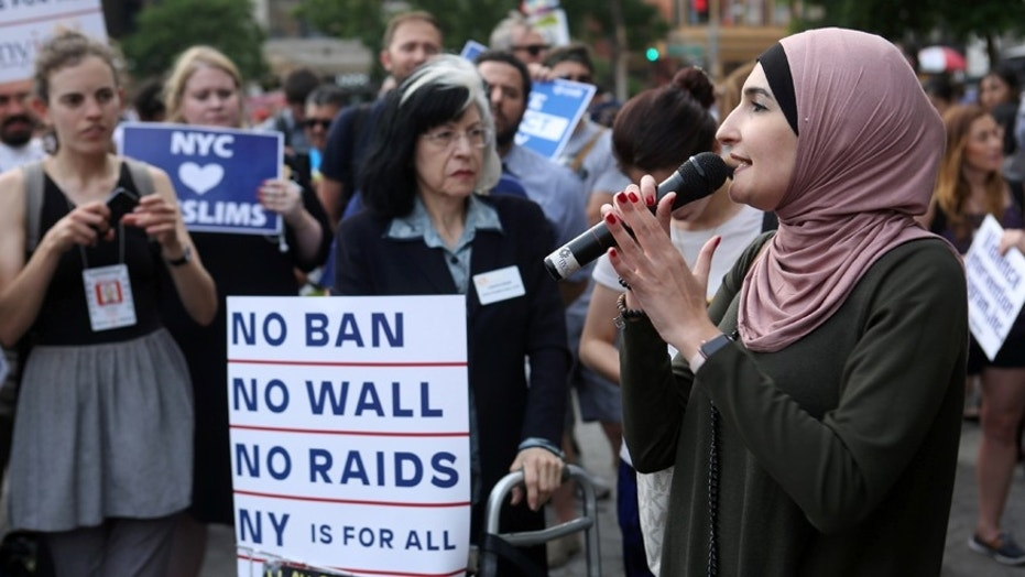 FILE -- Activist Linda Sarsour speaks at a protest against President Donald Trump's limited travel ban, approved by the U.S. Supreme Court, in New York City, U.S., June 29, 2017.