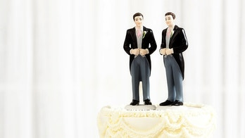 Subject: Same sex marriage wedding cake with two male groom figurine cake toppers.