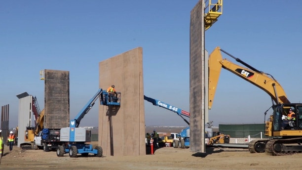 Construction crews continue building prototype models of the proposed wall along the Southwest border between the United States and Mexico. The construction site is located near the Otay Mesa Port of Entry in San Diego, CA. 
