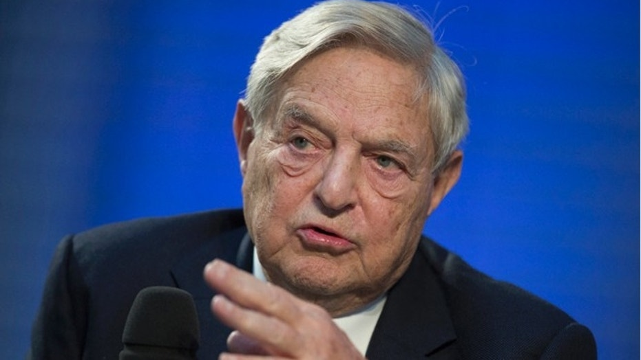 FILE -- Soros Fund Management Chairman George Soros speaks during a panel discussion at the Nicolas Berggruen Conference in Berlin, October 30, 2012.