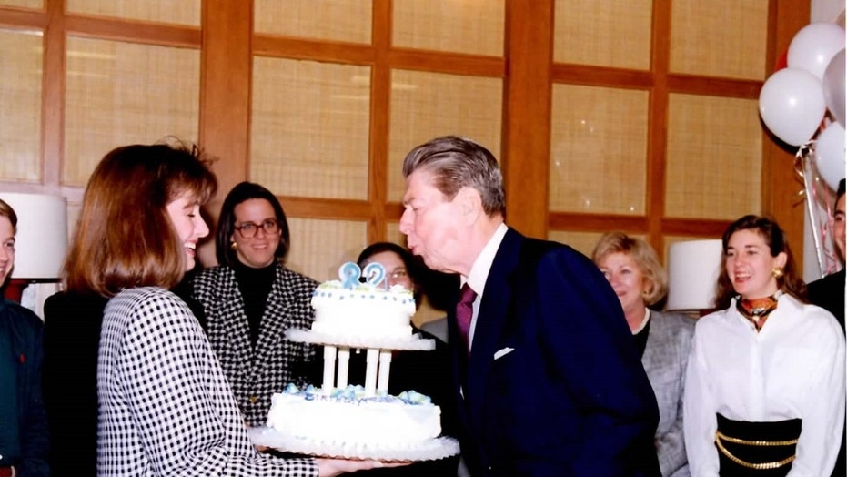 Ronald Reagan blows out the candles on his 82nd birthday, February 6, 1993, in his post-presidential office in Century City, California.