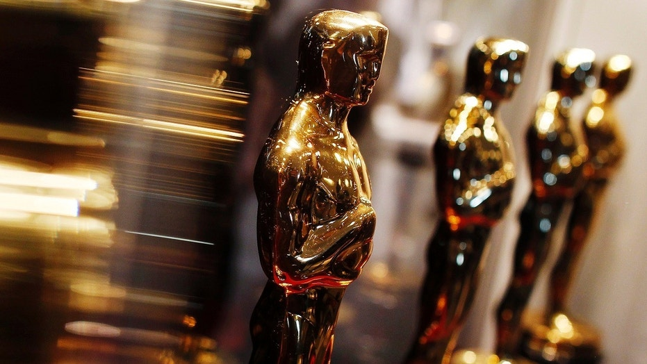 "FILE -- Oscar statuettes are displayed at the ""Meet the Oscars"" exhibit in New York February 25, 2010."
