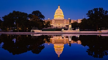 Capitol building with reflections at dusk Washingtom DC, USA