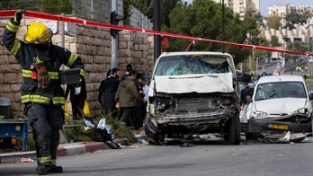Nov. 5, 2014: An Israeli fire fighter walks at the scene of an attack in Jerusalem. A Palestinian man rammed his car into a crowded train platform in east Jerusalem on Wednesday and then attacked people with an iron bar, killing one person and injuring 13 in what authorities called a terror attack before he was shot dead by the police. The militant Islamic group Hamas took responsibility for the attack.