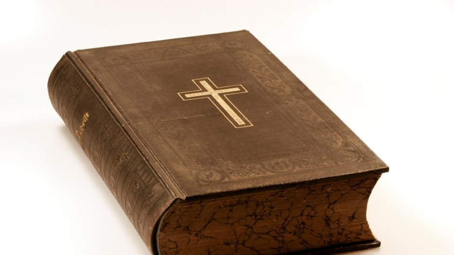 A historical bible on a white backround