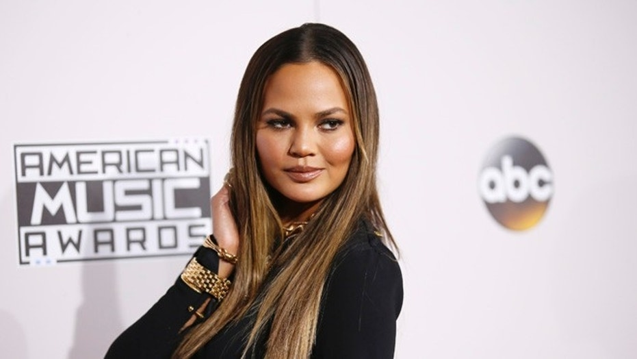 FILE -- Chrissy Teigen arrives at the 2016 American Music Awards in Los Angeles, California, November 20, 2016.