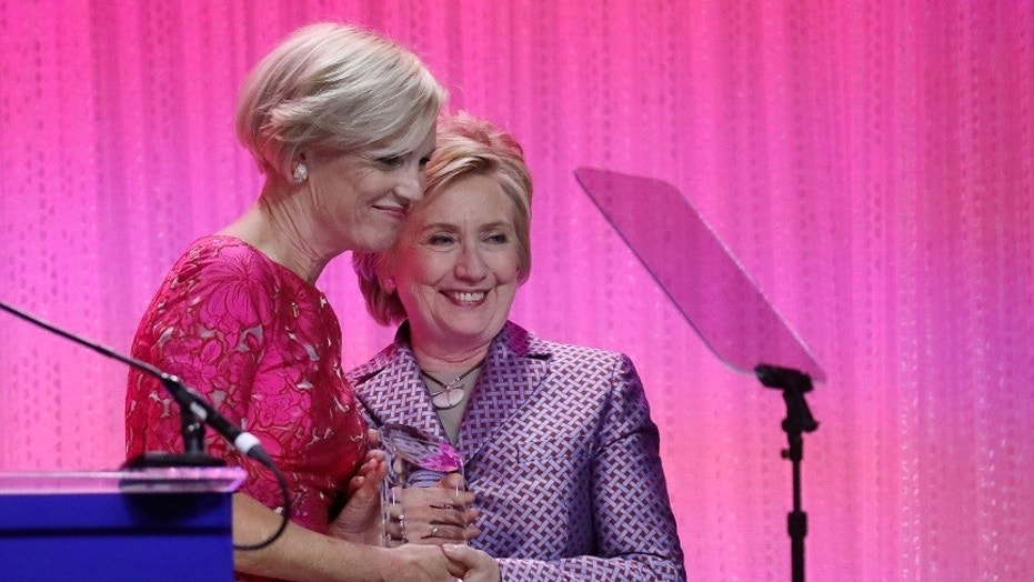 Hillary Clinton stands with Cecile Richards, president of Planned Parenthood Federation of America, during the Planned Parenthood 100 Years Gala in New York, May 2, 2017.