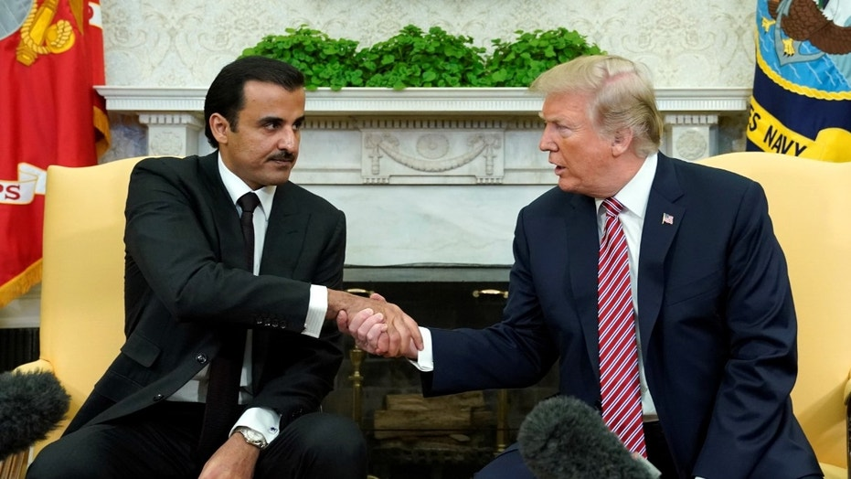 FILE -- President Donald Trump meets Qatar's Emir Sheikh Tamim bin Hamad al-Thani in the Oval Office at the White House in Washington, April 10, 2018.