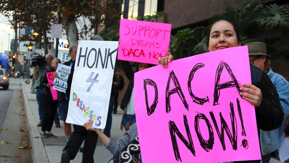 FILE -- Demonstrators urging the Democratic Party to protect the Deferred Action for Childhood Arrivals Act (DACA) rally in California.