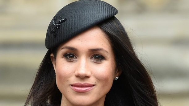 Meghan Markle, the fiancee of Britain's Prince Harry, attends a Service of Thanksgiving and Commemoration on ANZAC Day at Westminster Abbey in London, Britain, April 25, 2018. Eddie Mulholland/Pool via Reuters - RC1161C31410