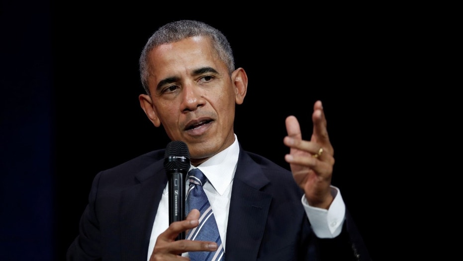 FILE - Former President Barack Obama speaks at a conference during his first visit to France since he left the White House.