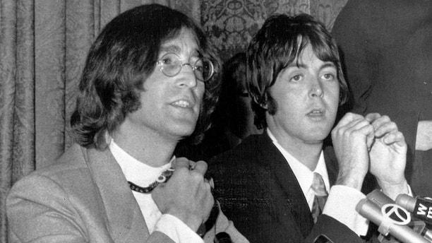 Members of the British pop group The Beatles, John Lennon, left,and Paul McCartney, announce that Beatles Ltd., is being reorganized for bigger things as Apple Corps Ltd., in New York, NY, May 15, 1968. The new company, owned equally by all four Beatles, will make films, produce records and own clothing stores in London. (AP Photo)