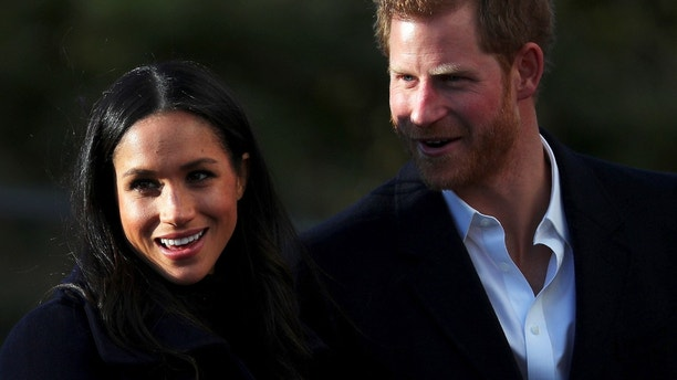 Britain's Prince Harry and his fiancee Meghan Markle visit a school in Nottingham, December 1, 2017. REUTERS/Hannah McKay - RC159B600570