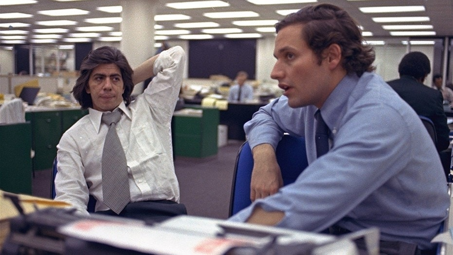Reporters Bob Woodward, right, and Carl Bernstein, whose reporting of the Watergate case won a Pulitzer Prize, sitting in the newsroom of the Washington Post in 1973.