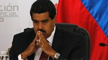 Venezuela's interim President Nicolas Maduro sits as he waits for the official ceremony at the Electoral Council to certify his victory on Sunday's presidential election in Caracas, Venezuela, Monday, April 15, 2013. Venezuela's government-friendly electoral council has quickly certified the razor-thin presidential victory of Hugo Chavez' hand-picked successor. Nicolas Maduro was elected by a margin of 50.8 percent to 49 percent over challenger Henrique Capriles.(AP Photo/Ariana Cubillos)