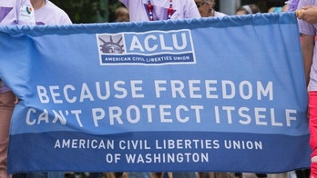 """""""Seattle, Washington, USA - June 24, 2012: A group of people march in the Seattle Gay Pride Parade, promoting the ACLU.  The American Civil Liberties Union supports human rights campaigns including gay rights."""""""