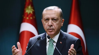Turkey's President Recep Tayyip Erdogan addresses a meeting in Ankara, Turkey, Thursday, Oct. 20, 2016. Turkish jets have struck the U.S.-backed Syrian Kurdish militia north of the embattled city of Aleppo, killing as many as 200 militia members, Turkey's state-run news agency reported Thursday. The Anadolu Agency, quoting military officials, said the raids were carried out late Wednesday night, attacking 18 targets in the Maarraat Umm Hawsh region in northern Syria.(Kayhan Ozer, Presidential Press Service, Pool photo via AP)