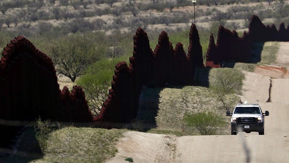 FILE--In this April 10, 2018, file photo, a Customs and Border Patrol agent patrols the international border near Nogales, Ariz.