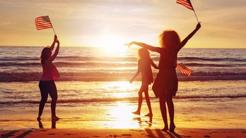 Friends celebrating 4th of July at the beach, California