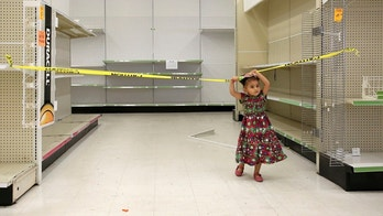 Two-year-old Sparrow Simon plays in an empty isle of the Toys R Us store, Thursday, June 28, 2018, in Houston. Toys R Us is closing its last U.S. stores by Friday, the end of a chain known to generations of children and parents for its sprawling stores, brightly colored logo and Geoffrey the giraffe mascot.    (Godofredo A. Vasquez/Houston Chronicle via AP)