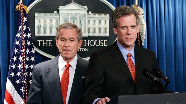 Newly named White House press secretary Tony Snow (R) speaks after being introduced by U.S. President George W. Bush in the briefing room in Washington April 26, 2006. Snow, a Fox News Radio host, replaced Scott McClellan who announced his resignation last week as part of a staff shake-up engineered by new White House Chief of Staff Josh Bolten aimed at reviving Bush's presidency.   REUTERS/Jim Young - GM1DSLXXZSAA