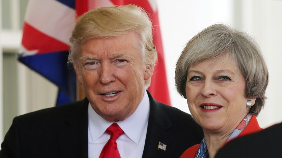 FILE --  January 27, 2017: U.S. President Donald Trump greets British Prime MinisterTheresa May as she arrives at the White House.