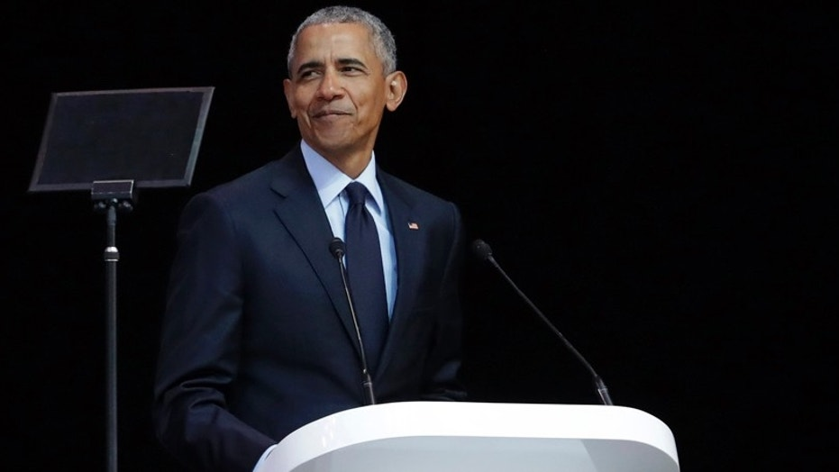 FILE -- Former U.S. President Barack Obama, left, delivers his speech at the 16th Annual Nelson Mandela Lecture at the Wanderers Stadium in Johannesburg, South Africa, Tuesday, July 17, 2018.