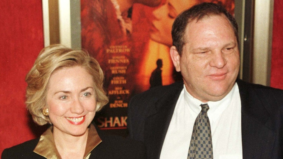"FILE -- Former first lady Hillary Rodham Clinton and Harvey Weinstein as they arrive for the premiere of ""Shakespeare in Love"" in New York."