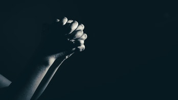 praying woman hand in the dark ( praying in secret room concept )in white tone