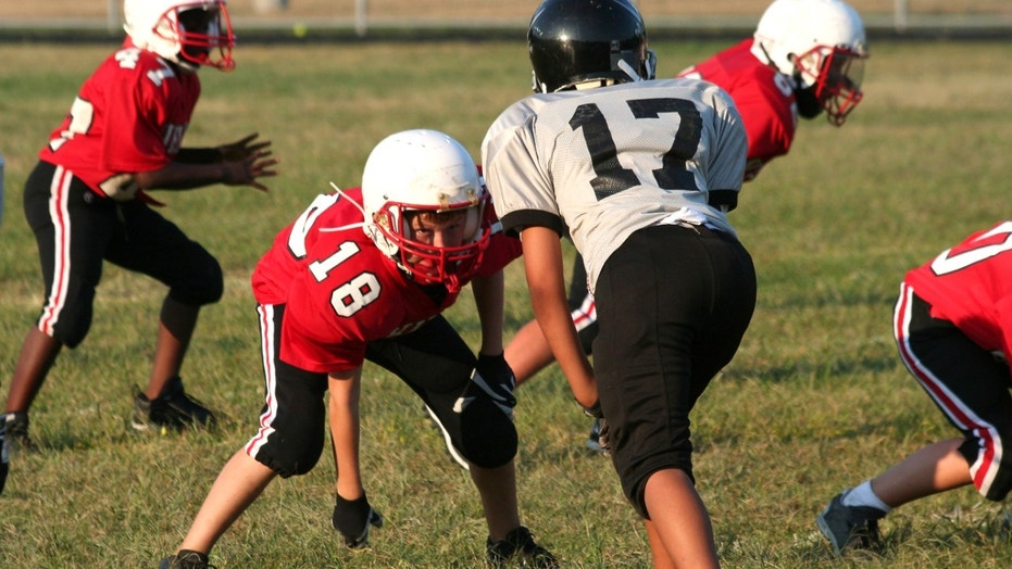 Youth football player in a middle of a game